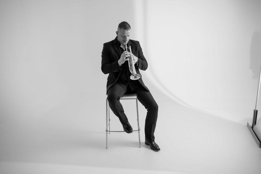 Musician Morris Sebastianutto photos with trumpet